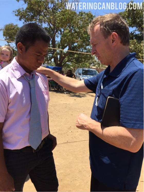 Pastor Doug praying with a young man called to ministry.   Toliara, Madagascar